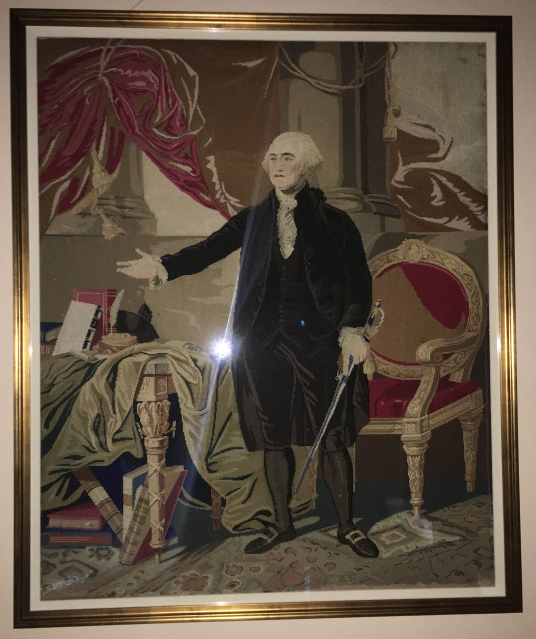 A picture of the 19th Century Needlework depicting Gilbert Stuart's Landsdowne portrait of George Washington